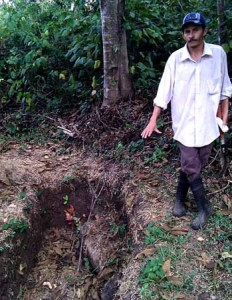 Efren and a small water retaining trench, that also slows destructive run-off in the wet season