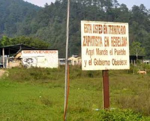 "The Zapatistas mark their territory with defiant signs such as this one; ""Here the people demand and the government obeys"""