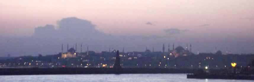 At sunset, the Istanbul skyline silhouttes the minarets of its many mosques
