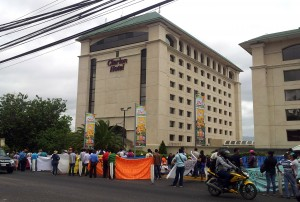 The marchers settled outside the closed doors of the Mining Congress, at the Clarion Hotel