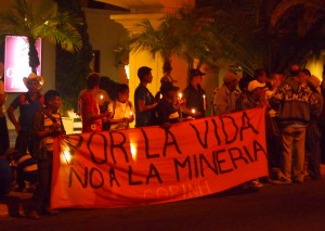 "The night before the anti-mining march, COPINH members held a candle lit vigil outside the inauguration ceremony of the Mining Congress. The banner reads ""For life, No to Mining, COPINH"""
